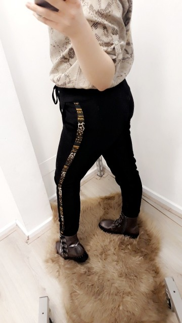 Black pants with a yellow stripe on the side